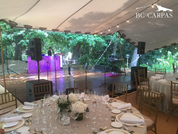A stretched marquee for a wedding during noon.